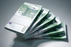 European Currency - Euro. A pile of papermoney on white background - gestapelte Geldscheine vor weissem Hintergrund stock photos