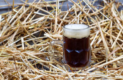European Dark Beer in Stein on Straw and wood Stock Photos