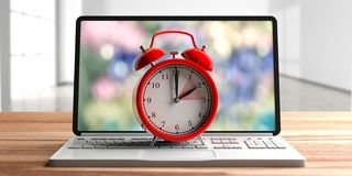 European daylight saving time. Red alarm clock on a computer laptop on wooden desk. 3d illustration stock photography