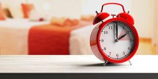 European daylight saving time. Red alarm clock on wooden desk, blur bedroom background, banner. 3d illustration royalty free stock photo