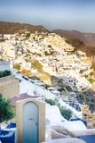European Destinations. Picturesque view of Cityscape of Oia Village in Santorini with Volcanic Caldera Mountain. Vertical Shot stock photo