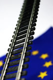European Development 2. Model railyway crossing european flag Stock Photo