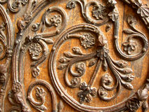 European door design. Design on a wooden door of a church in France Royalty Free Stock Photography