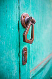 European door handle. On teal door Stock Photo
