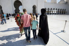 European Family at Sheikh Zayed Grand Mosque Abu Dhabi. NWoman with children Stock Photo