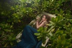 European Fashion model green dress. In Grove coffin royalty free stock photo