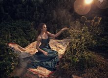 European Fashion model green dress. In Grove sunset stock image