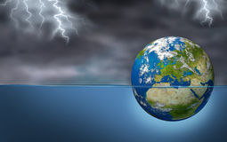 European Financial Crisis. As an earth planet of European union drowning in debt sinking in water during a storm with lightning as an economic Euro debt warning Stock Photography
