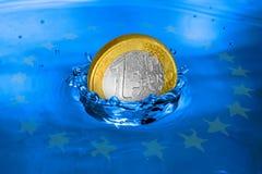 European financial crisis metaphor. Euro coin falling to the water. European financial crisis metaphor Royalty Free Stock Image