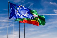 European flag against blue sky. European flag against cloudy, blue sky and national flags Royalty Free Stock Images