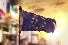 European Flag Against City Blurred Background At Sunrise Backlig. Ht Sky Stock Photography