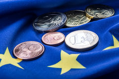 European flag and euro money.  Coins and banknotes European currency freely laid on the Eur Royalty Free Stock Photography