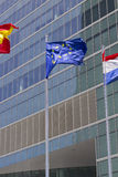 European flag. With modern building on the background Royalty Free Stock Photography