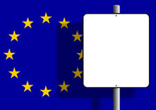 European flag sign post. Flag of the european union under a blank sign nailed to a post Royalty Free Stock Photos
