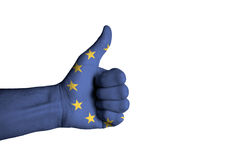 European flag on thumb up male hand. European  flag on thumb up male hand Royalty Free Stock Photos