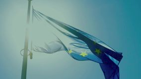 European flag with twelve yellow stars against sun stock footage