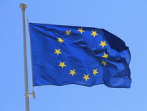 European flag with twelve yellow stars on blue sky Royalty Free Stock Photography