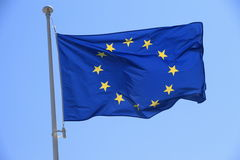 European flag with twelve yellow stars on blue sky Royalty Free Stock Image