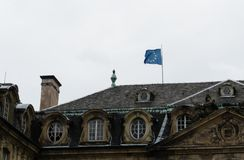 European flag waves on the top of a house in strasbourg.  Royalty Free Stock Photos