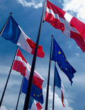 European Flags. Some flags of Europe including European union flag set against a blue sky.Danish flag .French flag Stock Photo
