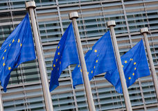 European flags. In front of the Berlaymont building, headquarters of the European commission in Brussels Stock Images