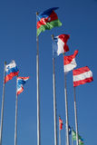 The European flags. Against on the blue sky Royalty Free Stock Image