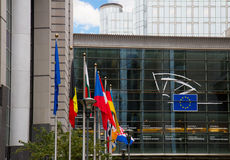 European flags and  Europen parlament, Brussels Royalty Free Stock Photography
