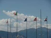 European flags flying along the shores of the lake. Close up of European flags flying along the shores of the lake royalty free stock photography