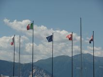 European flags flying along the shores of the lake stock image