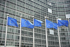 European flags in front of the Berlaymont building Royalty Free Stock Images