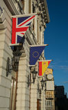 European Flags outside a building. A Spanish, UK and European flag, hanging outside a European building Royalty Free Stock Image