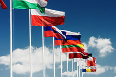 European flags. Row of European country flags against blue cloudy sky background stock photo