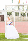 European Football Championship concept. Bride on the football stadium. Royalty Free Stock Images