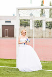 European Football Championship concept. Bride on the football stadium. Stock Images