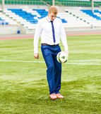 European Football Championship concept. Businessman playing soccer ball. Royalty Free Stock Photos