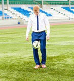 European Football Championship concept. Businessman playing soccer ball. Stock Photography