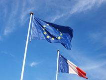 European and French flags. A shot of the European and French banner on a blue sky royalty free stock image