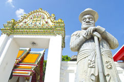 European giant statue at Wat Pho temple Stock Photography