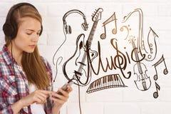 European girl listening to music Royalty Free Stock Image