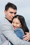 European guy embracing Korean girl Royalty Free Stock Image