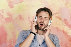 European guy have fun time. Cheerful teenage dj listening songs via earphones. Musical lifestyle. Blue eyed stylish. Hipster with smartphone. American handsome stock images