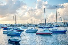 European harbor with maltese yacht and boat Stock Image