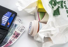 European health insurance card in a wallet along with several pounds sterling and medicines in a bag, concept of medical increase. In the crisis of the brexit royalty free stock photography