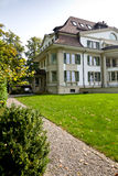 European house. Beautiful european house with green lawn stock image