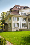 European house with green lawn Royalty Free Stock Photos