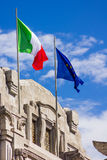 European and Italian flags on a monument Stock Image