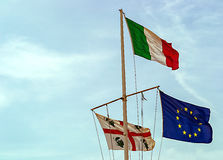 European, Italian and Sardinia`s flag. Moved by the wind Royalty Free Stock Photo