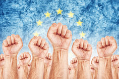 European Labour movement, workers union strike. Europe Labour movement, workers union strike concept with male fists raised in the air fighting for their rights Stock Photo