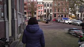 European lady tourist walks the city. slow motion.  stock footage