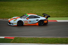 European Le Mans Series Porsche 911 RSR GT3 at Imola 2015. Gulf Racing UK Porsche 911 RSR GT3 nr.86 at the Acque minerali corner of Imola circuit during Saturday Royalty Free Stock Image